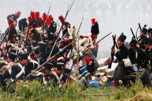 History enthusiasts, dressed as members of the French and British Army, fight during a re-enactment of Napoleon's famous battle of Waterloo in Braine-l'Alleud June 21, 2009. Brandishing guns and bayonets near Waterloo, just south of Brussels, some 1,200 men from 12 countries gathered on Sunday to re-enact the 1815 battle that ended Napoleon's imperial dream. REUTERS/Thierry Roge (BELGIUM SOCIETY IMAGES OF THE DAY) - RTR24VOB
